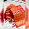 Orange color banarasi jacquard silk saree with beautiful tassel work