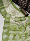 Green and off white color banarasi art silk saree with zari weaving work