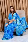 Sky blue color pure bandhej silk saree with zari weaving border