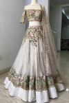 Off white color net lehenga with embroidery work