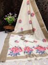 Off white color pure linen weaving saree with zari woven border & pallu