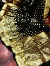 Black color banarasi soft silk saree with gold zari woven border