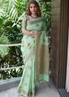 Green color linen cotton saree with zari weaving border