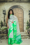 Green and silver color tissue silk saree with zari weaving work