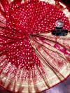 Pink color banarasi soft silk saree with gold zari woven border
