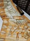 Yellow and off white color banarasi art silk saree with zari weaving work