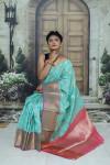 Sea green color kanchipuram handloom weaving silk saree with zari woven work