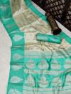 Sea green and off white color banarasi art silk saree with zari weaving work