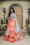 Orange and silver color tissue silk saree with zari weaving work