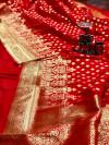 Red color banarasi soft silk saree with gold zari woven border