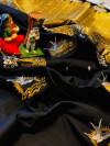 Black color soft lichi silk saree with attractive gold and silver zari weaving work