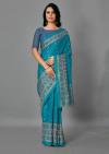 Firoji color jute silk saree with printed work