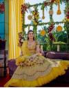 Yellow color mono net lehenga with heavy embroidery work