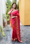 Pink and orange color bandhej silk saree with zari weaving work