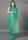 Rama green color cotton silk saree with weaving work