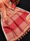 Peach color metallic linen silk saree with zari work