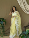 Yellow color organza saree with threads & sequence work