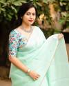 Sea green color dola silk saree with mirror work & aari brorder