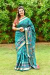 Rama green color patola silk saree with weaving work