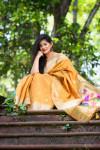 Yellow color banarasi tussar silk paithani saree with zari woven work