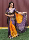 Purple and yellow color bandhej silk saree with zari weaving work