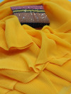 Yellow color georgette saree with crush work