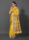Yellow color patola silk saree with printed work