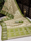 Mehndi green color art silk saree with satin woven border