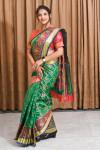 Green color patola silk saree with jequard weaving work