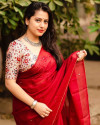 Red color dola silk saree with mirror work & aari brorder