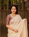 Peach color dola silk saree with mirror work & aari brorder