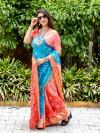 Orange and sky blue color bandhej silk saree with zari weaving work