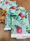 Sea green color linen saree with printed work