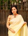 Yellow color dola silk saree with mirror work & aari brorder
