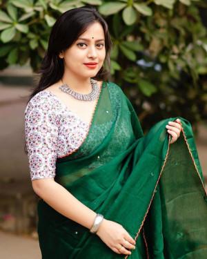 Green color dola silk saree with mirror work & aari brorder