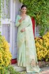 Green color kamchipuram tissue silk saree with zari woven work