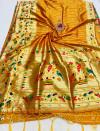 Orange color paithani silk saree with golden zari  weaving work