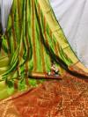 Parrot green color banarasi patola silk saree with weaving work
