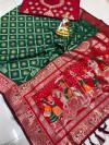 Dark green color soft banarasi silk saree with zari weaving work