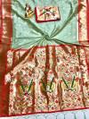 Sea green color paithani silk saree with weaving work