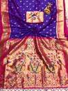 Purple color paithani silk saree with weaving work