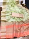 Pista green color organza silk saree with woven work