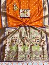 Orange color paithani silk saree with weaving work