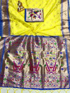 Yellow color paithani silk saree with weaving work