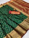 Dark green color soft banarasi silk saree with zari woven rich pallu and border