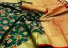 Dark green color handloom soft silk saree with zari weaving work