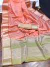 Peach color organza silk saree with woven work