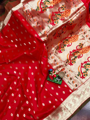 Red color paithani silk saree with weaving work