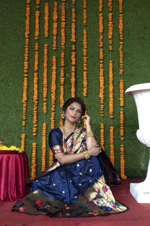 Navy blue color paithani silk saree with zari weaving work