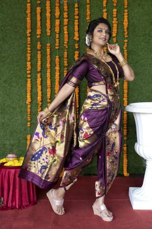 Magenta color paithani silk saree with zari weaving work